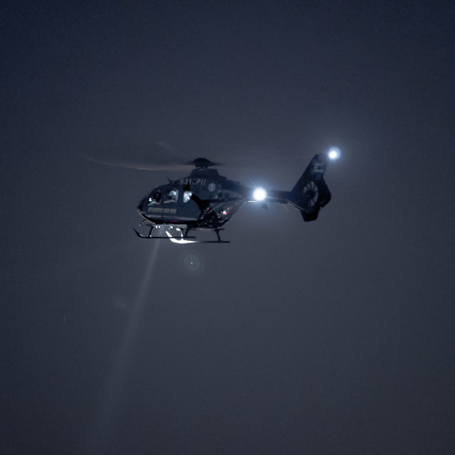 """HELICOPTER AT NIGHT"" stock image"
