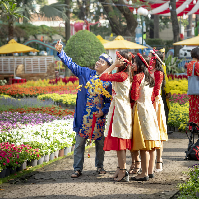 """in the Lunar New Year, Vietnamese people and tourists were in Tao Dan park happily to enjoy the atmosphere of spring"" stock image"