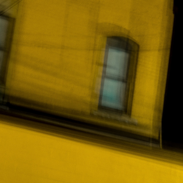 """OUT OF FOCUS YELLOW BUILDING"" stock image"
