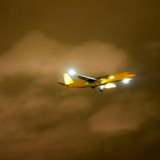 """AIRPLANE FLYING AT NIGHT IN THE CLOUDS"" stock image"