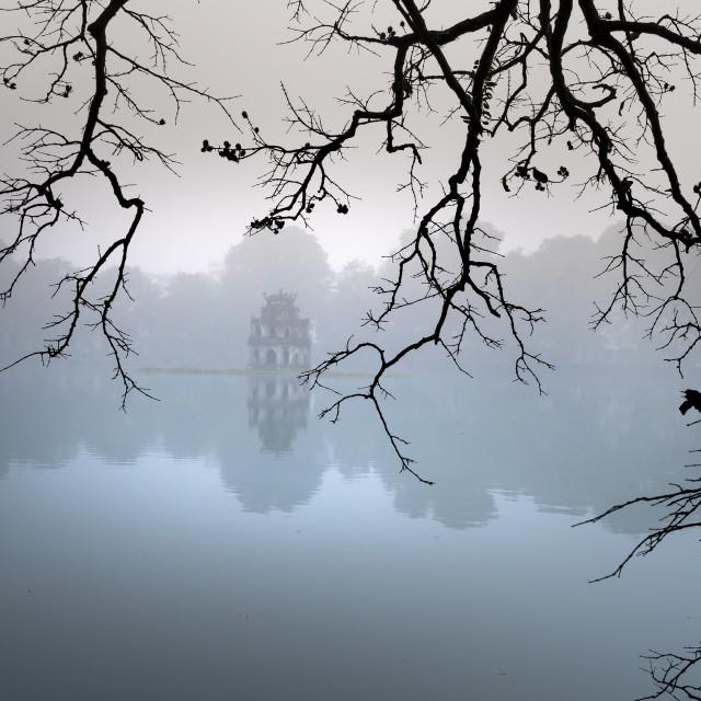 """Hoan Kiem Lake ( Ho Guom) in the center of Hanoi in the fog in the morning."" stock image"