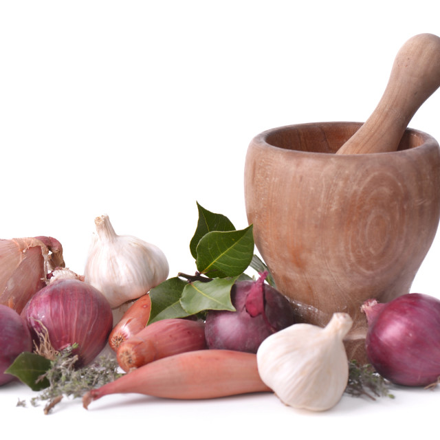 """""""onions, garlics and shallots with a wooden pestle on white background"""" stock image"""