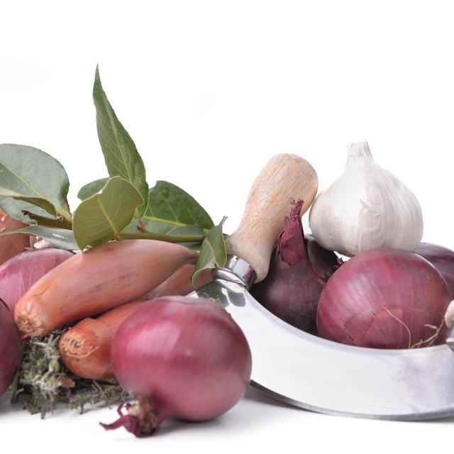 """""""onions, garlics and shallots with a manual chopper on white background"""" stock image"""