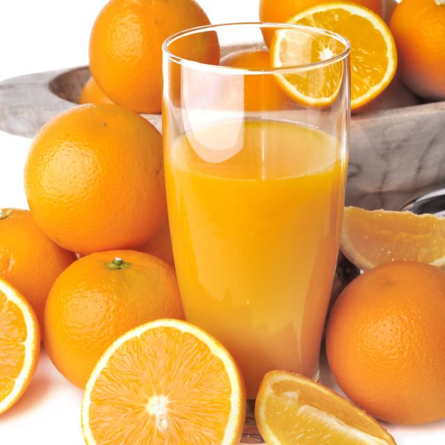 """""""glass of orange juice with fruits on white background"""" stock image"""