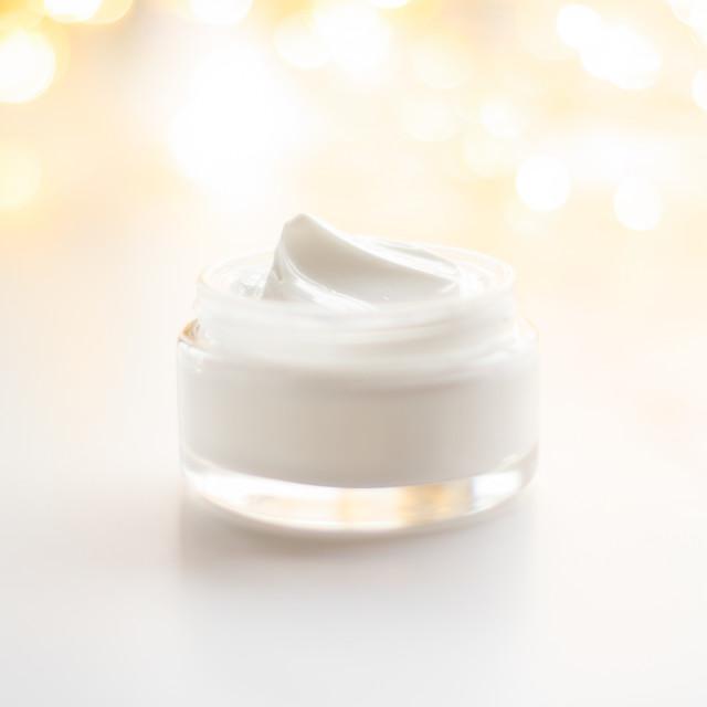 """Luxury face cream jar and holiday glitter"" stock image"