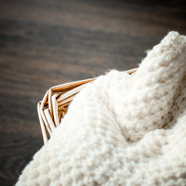 """Knitted winter clothes in a basket"" stock image"