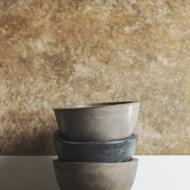 """""""Bowls of polished cement, handmade, stacked on the kitchen"""" stock image"""