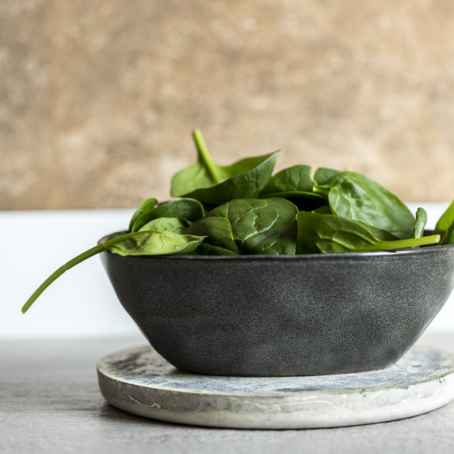 """""""Fresh spinach on a modern crockery bowl on the kitchen"""" stock image"""