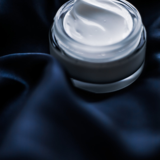 """Luxury face cream jar on a dark blue silk"" stock image"