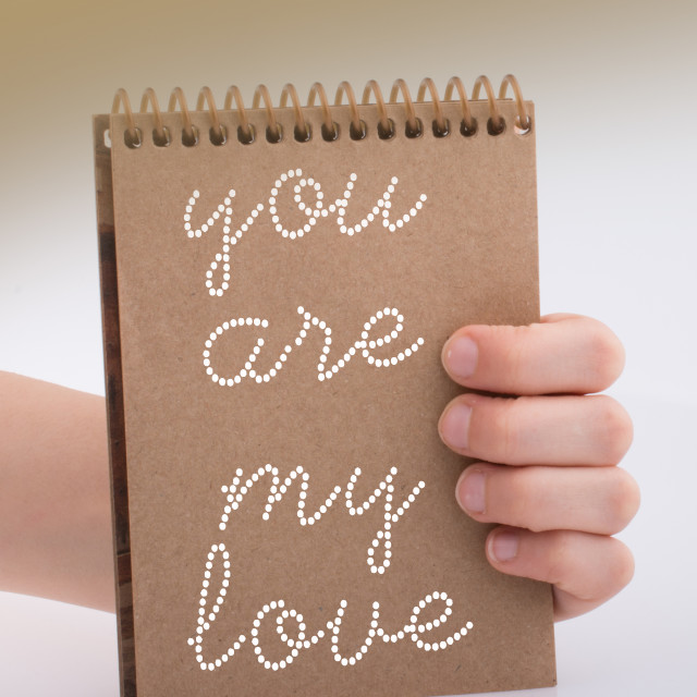 """You are my love text on notebook in hand as love cocept"" stock image"