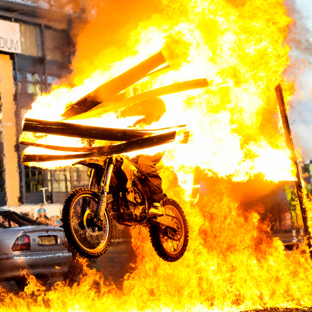"""Motorbike jumping through fire"" stock image"
