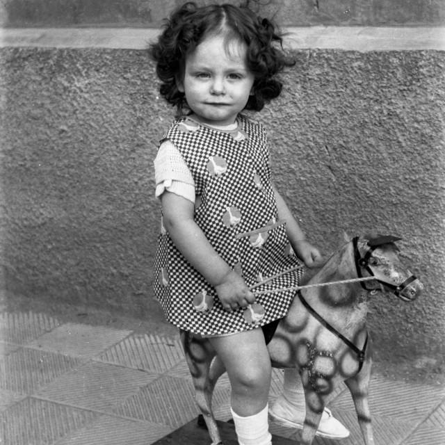 """VINTAGE PORTRAIT OF LITTLE GIRL ON A PONY"" stock image"