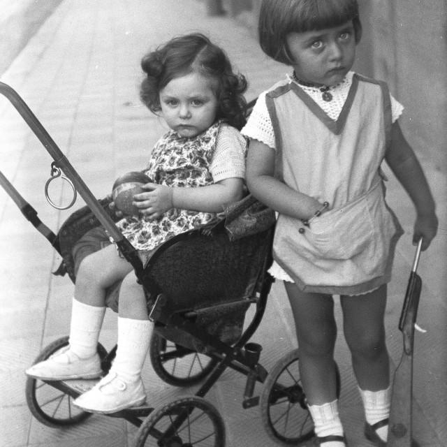 """VINTAGE PORTRAIT OF SISTERS ON A PARIS STREET"" stock image"