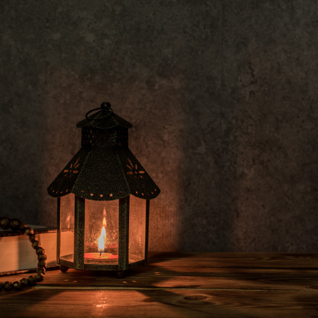 """""""Arabic lantern with candle and date palm fruit at night for Islamic holiday. Muslim holy month Ramadan."""" stock image"""