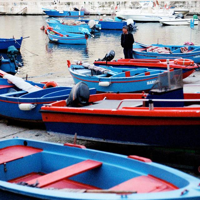 """Man and boats!"" stock image"
