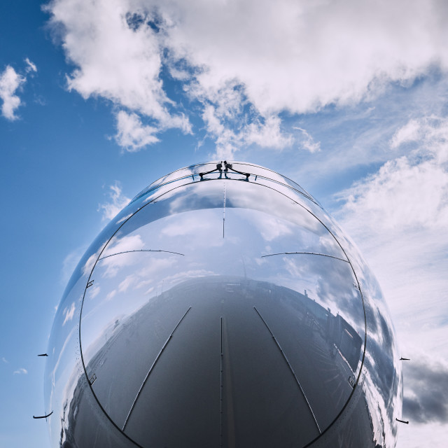 """""""Reflection of sky on airplane"""" stock image"""