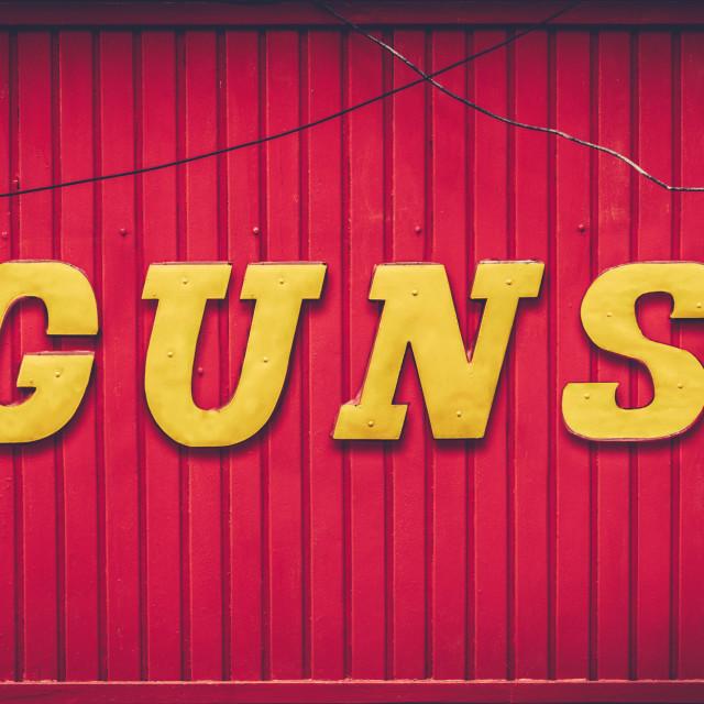 """Retro Red Gun Store Sign"" stock image"