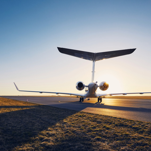 """Private jet at sunset"" stock image"