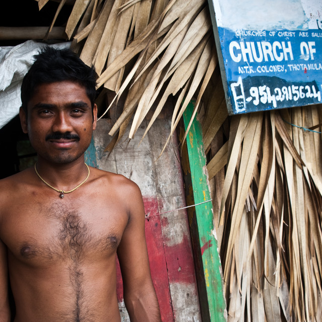 """Christian man in front of a church ( India)"" stock image"