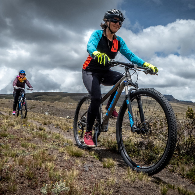 """Mountain biking in Cotopaxi National Park"" stock image"