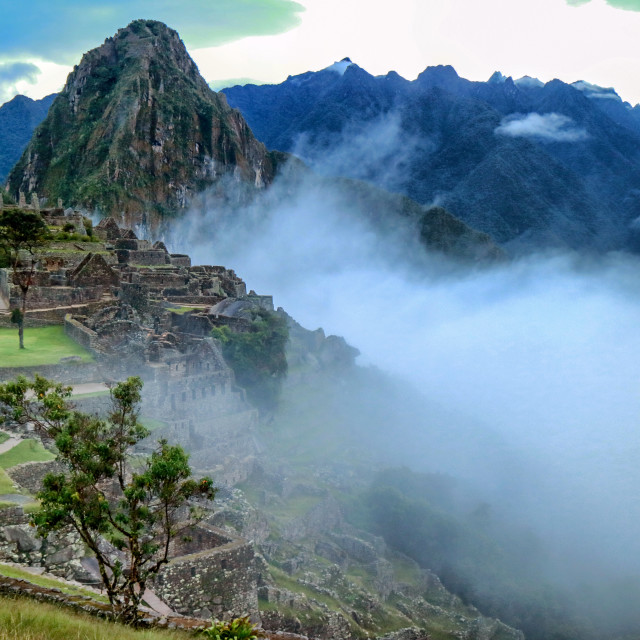 """Misty view of Machu Picchu after the rain"" stock image"