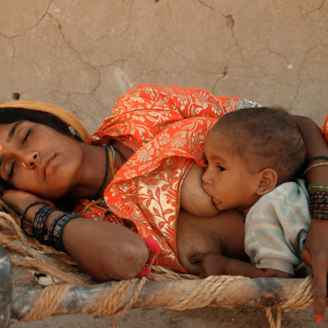 """Mother and son in the Thar desert ( India)"" stock image"