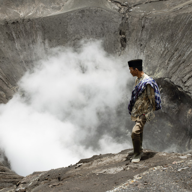 """Tenggerese Man Standing On The Edge Of An Active Volcano In Bromo"" stock image"
