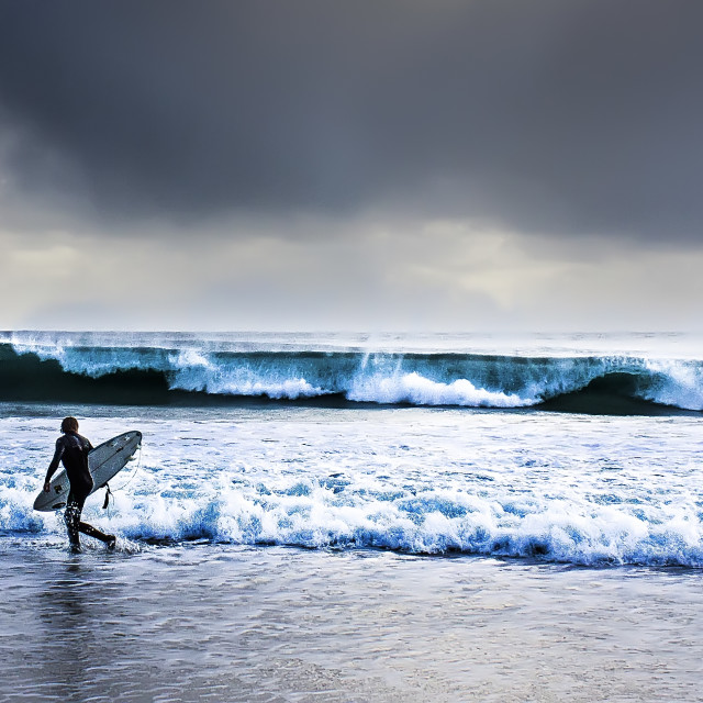 """Surfer at Porthcurno, Cornwall"" stock image"