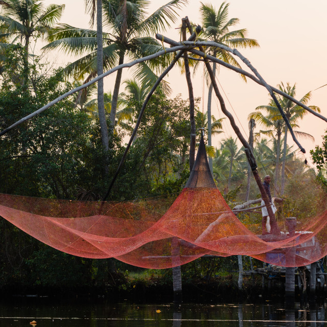 """ERAMALLOOR, INDIA - 6 Feb 2017: A traditional Chinese fishing net is raised..."" stock image"