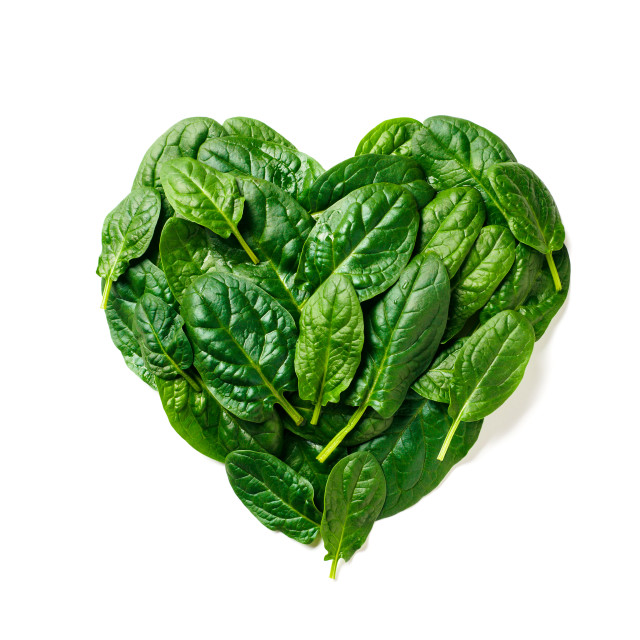 """""""Heart shape made from spinach leaves, isolated"""" stock image"""