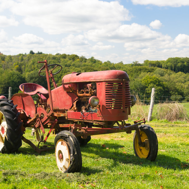 """""""Vintage red tractor in landscape"""" stock image"""