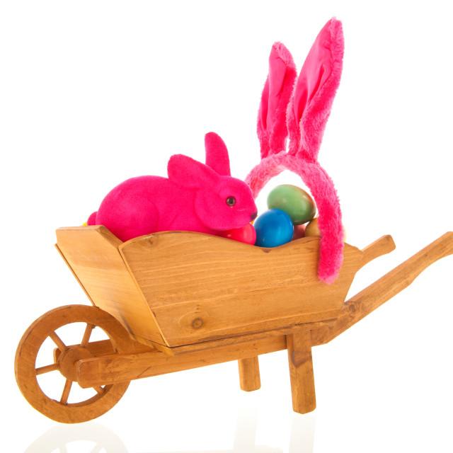 """Wheelbarrow easter eggs"" stock image"