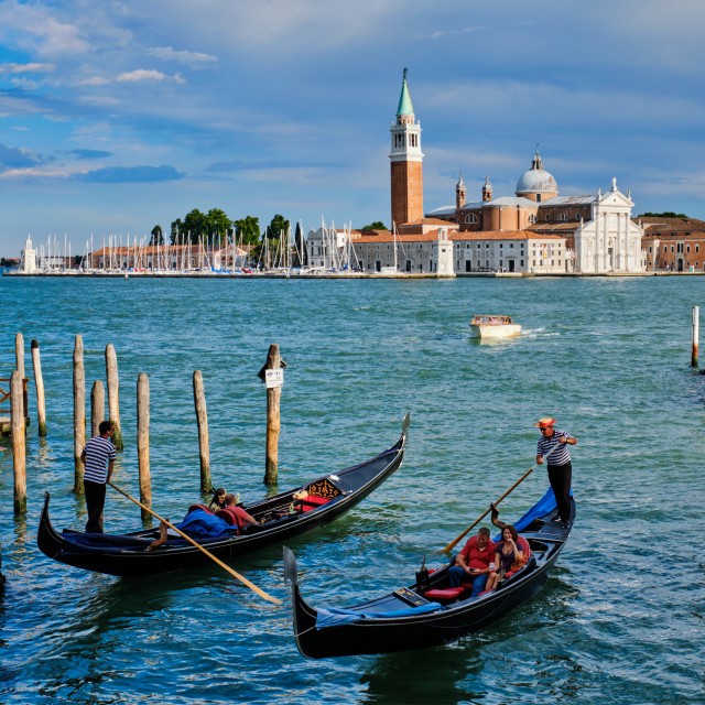 """""""Gondolas and in lagoon of Venice by Saint Mark (San Marco) square"""" stock image"""