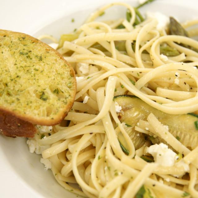 """Linguine with Feta Cheese, Zucchini and Garlic Bread"" stock image"