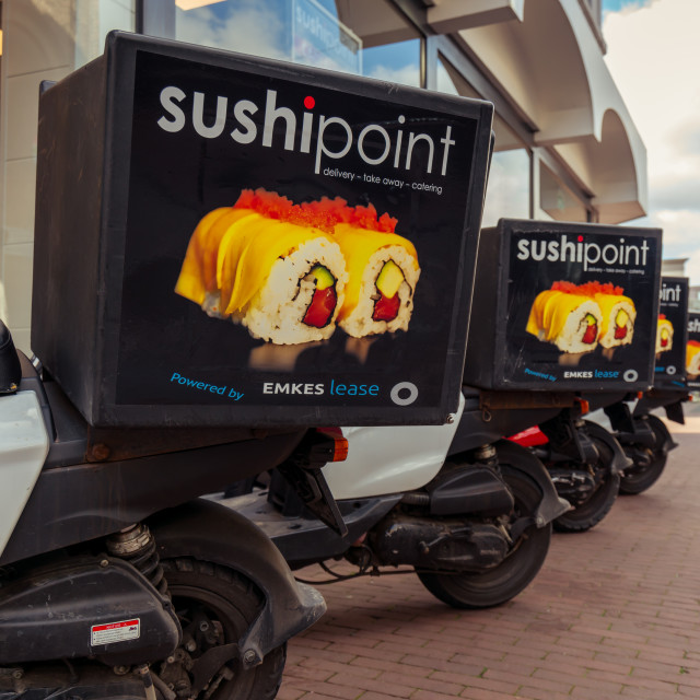 """""""SushiPoint scooters in a row"""" stock image"""