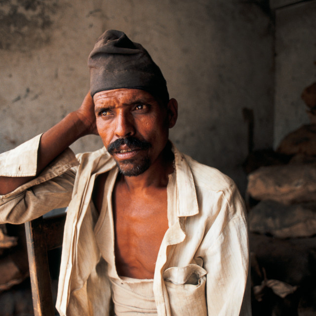 """""""Employee in a charcoal shop ( Nepal)"""" stock image"""
