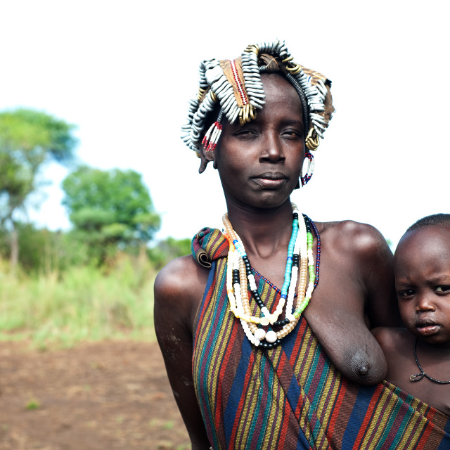 """Mother and son from the Mursi tribe ( Ethiopia)"" stock image"