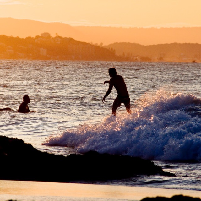 """Golden hour surfing"" stock image"