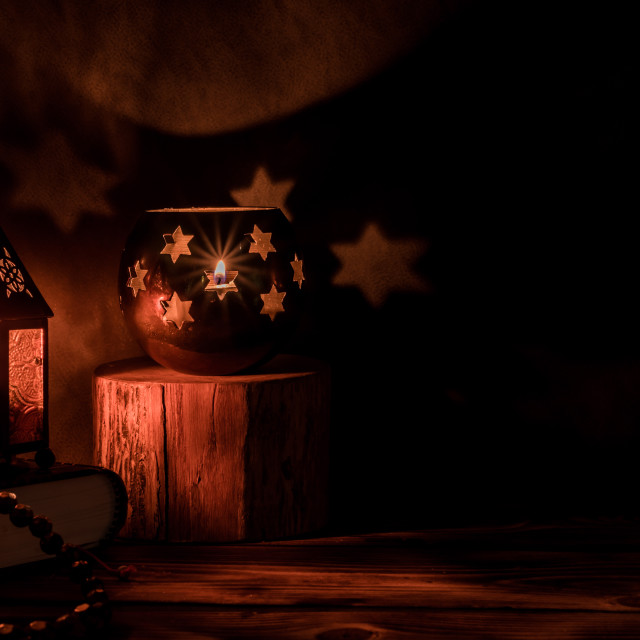 """""""Arabic lantern with candle at night for Islamic holiday. Muslim holy month Ramadan. The end of Eid and Happy New Year. Copy space on dark background."""" stock image"""