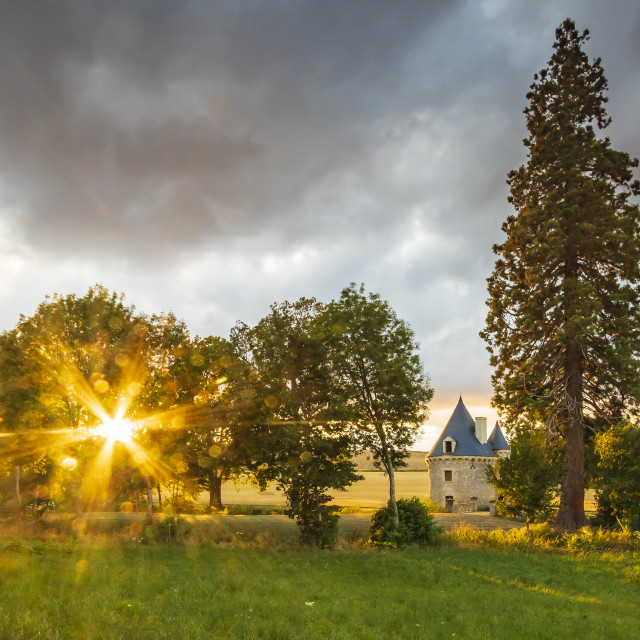 """""""Small hidden castle during sunset on a dreamlike landscape"""" stock image"""