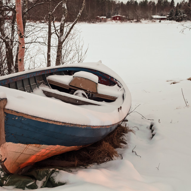 """""""Old Fishing Boat Covered With Snow"""" stock image"""