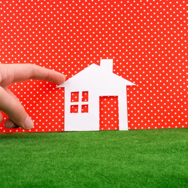 """""""Hand pointing Paper house"""" stock image"""