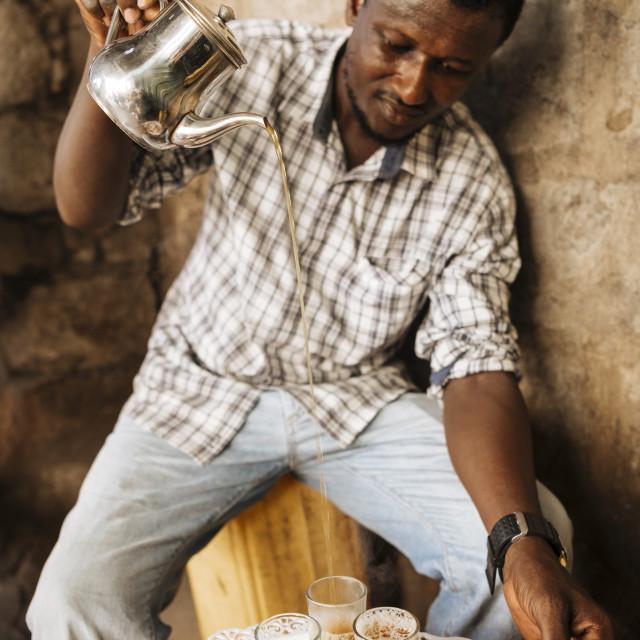 """Man making traditional tea, Accra, Ghana, Africa"" stock image"