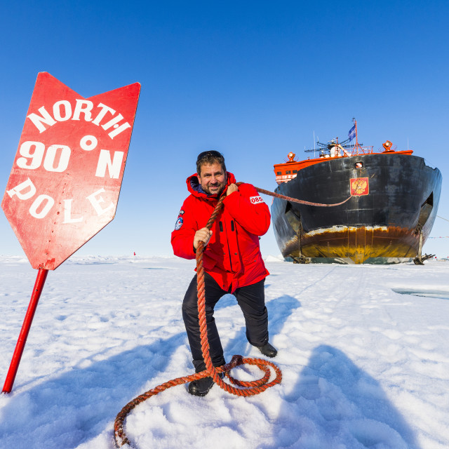 """""""Man pretending to pull the Icebreaker '50 years of victory' on the North..."""" stock image"""