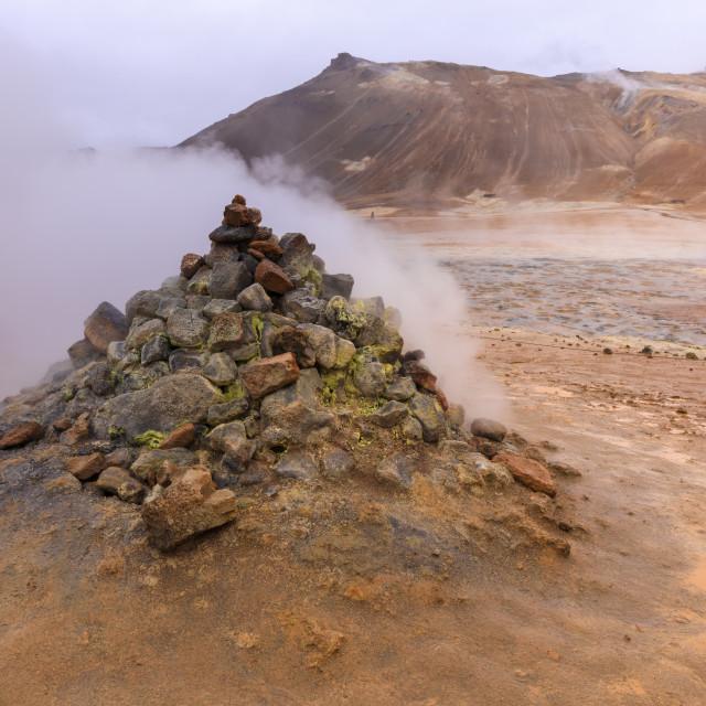 """Smoking fumerole, bright colours of sulphur, visitors, Namafjall Hverir..."" stock image"