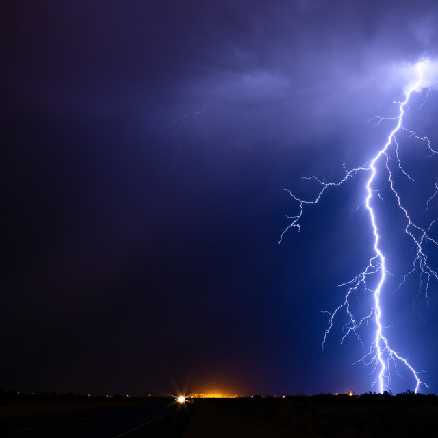 """Lightning bolt strike from a storm"" stock image"