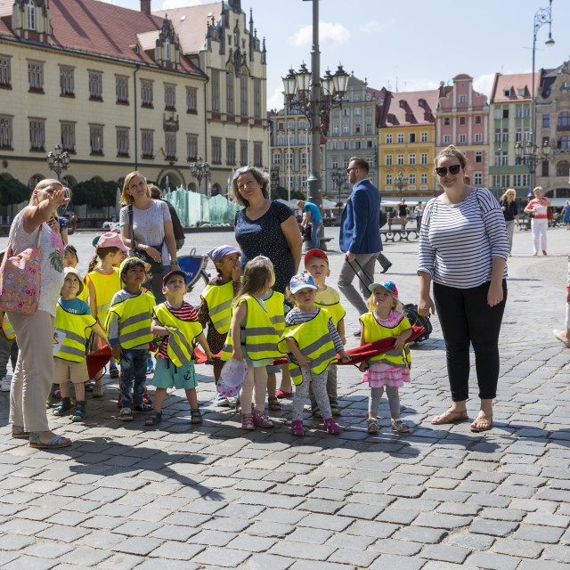 """""""Wroclaw, Poland - July 09, 2018: A group of young children on an excursion on the Market Square of Wroclaw, Poland."""" stock image"""