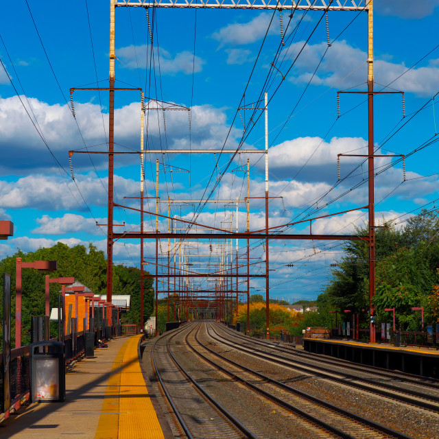 """Train tracks and blue sky"" stock image"