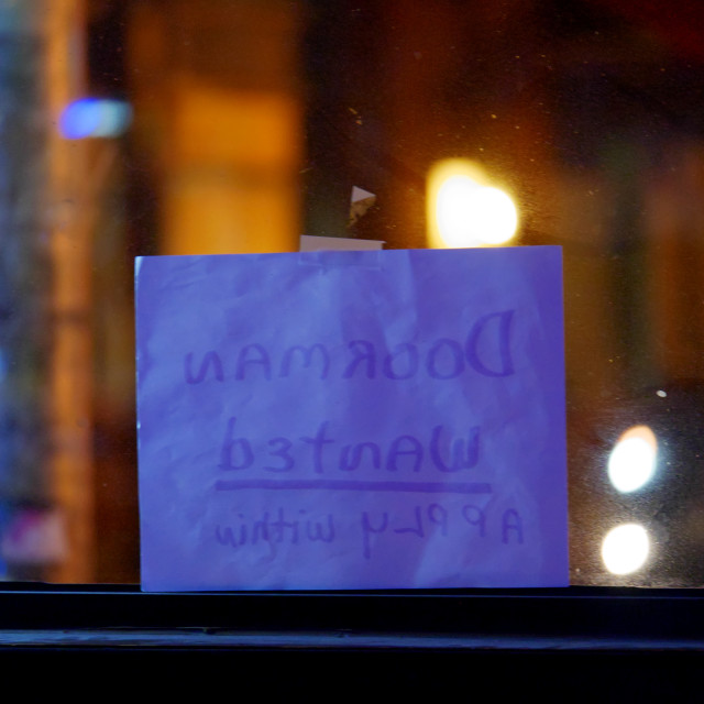 """Doorman Wanted sign in bar window"" stock image"