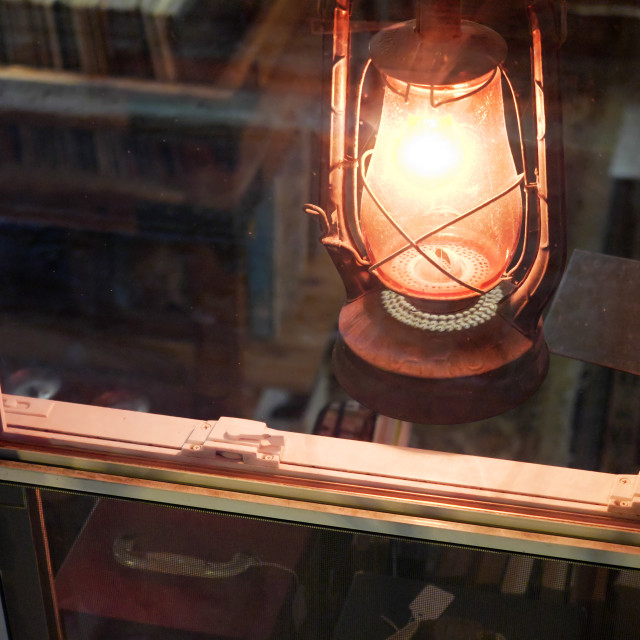 """Lantern in the window of a record store"" stock image"